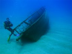 Scuba dive in a sunken ship.