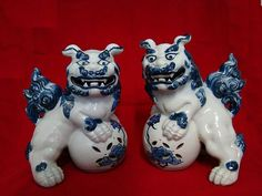 Chinese blue and white porcelain foo dog pair.  Circa early 20th century, 10 inches tall.