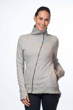 Asymmetrical full zip jacket with rib knit at collar, cuffs and hem.
