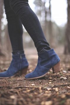 "Navy is one of the ""It"" colors for fall footwear. If you're feeling daring, splurge on a pair of navy boots. They'll go with more than you think. #fall #style"