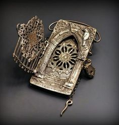 Story Lockets & Books by Christie Anderson.  Amazing work.