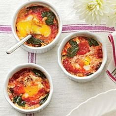 Special baked eggs - super easy! Spinach, tinned toms, pinch of chili flakes and, of course, eggsies. Just crack eggs over the other ingredients and bake in the oven.