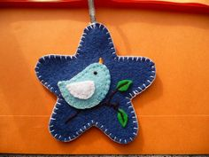 Star Felt Ornament @Kathy Davis-Reid Red Said: I wanted a rounded tip star shape & found a pattern for one HERE at Allsorts. I copied the image into Corel Draw & sized the image to the dimensions I was interested in. The dark blue felt is wool Melton cloth while the accents are acrylic because that's all I had on hand. Accent shapes are stitched on w/ a blanket stitch in 3 strands of embroidery floss...