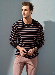 Keeping it simple, Christian Hogue wears a striped sweater and pink chinos by LE 31.