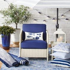 A distinct coastal feel is achieved just with the use of a few shades of blue and white, a few underwater motifs and a lot of natural materials. The Classic Blues and Whites Outdoor Decor Collection. Living Room End Tables, Rugs In Living Room, Living Room Decor, Potted Olive Tree, Outdoor Rugs, Outdoor Decor, Outdoor Lantern, Outdoor Furniture, Classic Blues