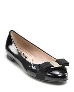 """I want these! Need to buy them this year love love Salvatore Ferragamo """"Varina"""" Bow Logo Flats $396  BTW Ferragamo shoes are no longer sold at Saks stores only online."""
