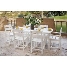 Classics 7-piece Dining Set by Ivy Terrace Costco $1599 comes in black