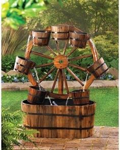Wagon Wheel Outdoor Water Fountain Product Description: Add some country charm with this casual all wood wagon wheel outdoor water fountain! An old fashioned wagon wheel becomes a quaint backdrop for Garden Water Fountains, Water Garden, Fountain Garden, Outdoor Fountains, Barrel Fountain, Garden Pond, Wagon Wheel Garden, Rustic Outdoor, Outdoor Decor