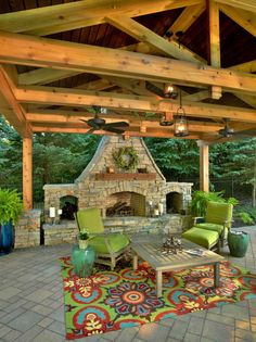 Outdoor stone fireplace, exposed wood, vibrant colors, lush greeney, candles, lanterns...Definitely a mind-blowing covered patio!