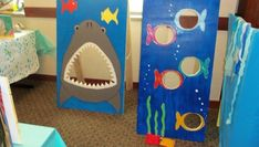 our custodians cut these boards and I painted them.shark for picture taking and fish for beanbag game Ocean Party, Water Party, Shark Party, Luau Party, Under The Sea Party, Mermaid Birthday, Birthday Party Themes, Ocean Underwater, Bag Toss