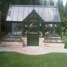 Victorian Greenhouse. Notice the cold frames on either side of the door; perfect for raising seedlings for early planting.