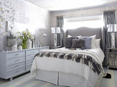 (and silver)  Cold-Weather Inspiration  To put a ho-hum Los Angeles guest bedroom to good use for winter guests, this 12x14 room's design was inspired by winter itself. From the icy blue and white stripes of the hardwood floors to the white birch bark wall covering, the room is wrapped floor to ceiling with touches of winter.