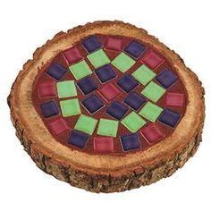 "Mosaic Woodland Coaster Craft Kit (makes 10) - Bring a taste of the outdoors inside with authentic wooden coasters rimmed with real bark. Glue colorful ceramic tiles into the carved inset of the coaster, grout and let set. Includes approx. 4""-diameter coasters, tiles, mosaic glue and shrink-resistant grout."