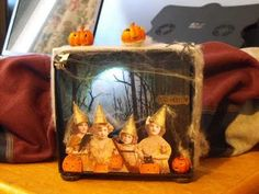 halloween shadow box  that lights up made by jullie dodds- great idea for grandkids IDEA: Cut out each child in various costumes & have them able to stand on their own so kids can change the scene as they wish!