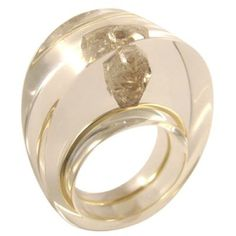 Organic cut diamond suspended in clear resin ring with gold detail.