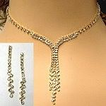 Gold plated rhinestone necklace set in delicate design popular for bridal and prom jewelry.  http://www.awnol.com/store/Rhinestone-Jewelry/Rhinestone-Sets