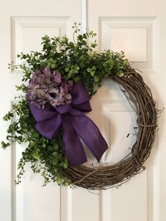SIMPLE BEAUTIFUL GRAPEVINE WREATH, approx. 19x23 Grapevine Wreath with a Large Hydrangea, Artificial Greenery, and Burlap Bow. Customize your own Wreath with the flower color and bow of your choice. Please send flower color and bow choice in notes to seller - Deep Coral, Purple, Blue, Pink, Cream, Red, White, Tan, Dark Orange, Lavender, Blush, Light Pink... (All flowers colors available, sorry no picture yet) Not all burlap ribbon colors are pictured. This wreath can have a Monogram added to…