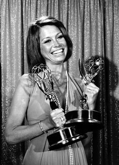 Moore holds her Emmys at the 26th Annual Primetime Emmy Awards in Los Angeles on May 28, 1974. Moore won Outstanding Lead Actress in a Comedy Series and Actress of the Year: Series for her role in The Mary Tyler Moore Show. The show won 29 Emmy Awards over its seven seasons. - A Look Back At The Life Of Mary Tyler Moore In Pictures - BuzzFeed News