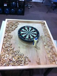 Custom dart board frame with wine cork backing, located in our design studio for brainstorming meetings at www.sixhalfdozen.com #winecorkcrafts