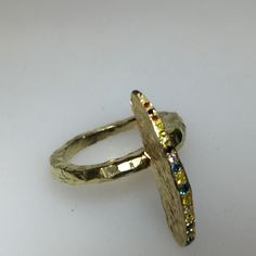 Shark fin 18k gold and colored diamond ring. One of a kind.