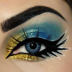 Fun colorful eyes - graphic bold eyeliner with yellow and blue shimmer eyeshadow