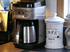 Cuisinart coffee maker and coffee bean canister. Coffee maker was bought from local classifieds website, canister was found at Value Village.