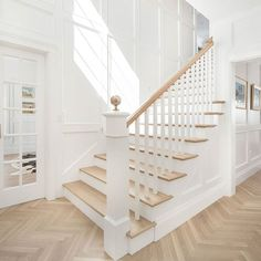 #Foyer #millwork #goals! The foyer features a #gorgeous wall #paneling and #hardwooflooring in #herringbone pattern. #Paintcolor is #BenjaminMoore Simply White. More details on HomeBunch. #Builder: @the_fox_group_ #interior #interiors #interiordesign
