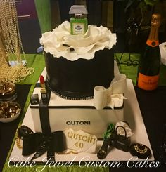 Black and white Coco Chanel inspired cake with fondant decorations. Shout out to De Voli Cakes for the original design inspiration!