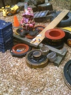 Using old tires, crates and planks of wood, you and a group of children can create some sort of obstacle course, or as the example I found shows, an 'outdoor lose parts' playground'