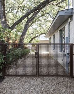 Out of all the cedar fence gate designs out there, this gorgeous, rustic wooden fence is the perfect touch as an entranceway to the garden! Fence gate ideas and design. Metal Driveway Gates, Front Gates, Front Yard Fence, Pool Fence, Backyard Fences, Fenced In Yard, Metal Gates, Farm Fence, Hog Wire Fence