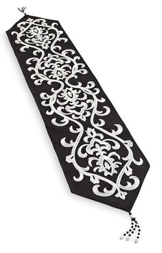 A Damask Table Runner expresses a worldly perspective