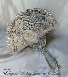 Glam Bouquets provides custom-made bridal brooch bouquets. Find custom wedding brooch bouquets perfect for any wedding including vintage bridal brooch bouquets, embellished brooch bouquets, & silk bouquets and much more. GlamBouquet.com