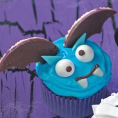 BATTY BATS CUPCAKES! Recipe. Ingredients     1 can (16 ounces) vanilla frosting     Blue paste food coloring     Cupcakes of your choice     Gum balls     Sticks Winterfresh gum     Fudge-striped cookies     1 can (16 ounces) chocolate frosting     Pastry tip—round tip # 3     Candy corn