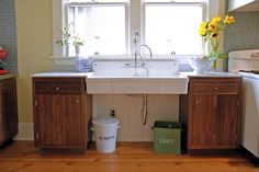 """""""We wanted cool colors that have a warm feeling,"""" says Anne. Gray-blue tile and soft yellow Venetian-plastered walls complement the natural wood floors and walnut lower cabinets."""