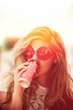 her hair, the sun, the glasses, the drink...