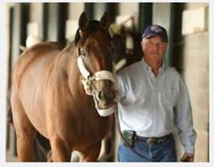 """So I showed Glenn a photo of Beholder with her trainer, Richard Mandella.  He said, """"She looks like Evander Holyfield in a horse suit."""""""