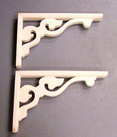 Vintage pair of wood shelf brackets - shabby - white. $14.99, via Etsy.