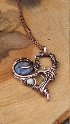 Heart Wire Wrapped Copper Pendant With Natural Gems Pendant is made of recycled copper wire and natural stones.I used Blue spot stone and one White Howlite .Wire is hammered, patinated and polished by hand.Perfect gift for a favorite person. Pendant is not covered with varnish and may