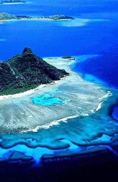The blue waters surrounding Tavarua Island in Fiji