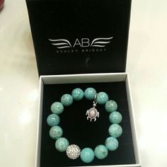 Ashley Bridget bracelet Blue turquoise beads with a turtle clamp and around sparkling ball have box Ashley Bridget Jewelry Bracelets