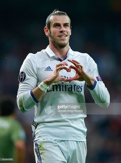 Gareth Bale of Real Madrid celebrates scoring his team's first goal during the UEFA Champions League Group F match between Real Madrid CF and Legia Warszawa at Bernabeu on October 18, 2016 in Madrid, Spain.