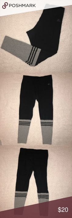 gray and black ADIDAS leggings Gently worn black Adidas leggings with gray bottom and 3 black stripes. Only worn a handful of times in great condition. adidas Pants Leggings