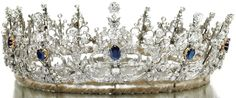 Gold, sapphire, and diamond tiara from the early 1900's. This piece is designed as a series of thirteen graduated stylized ribbon and scroll elements. The ribbons and scrolls are set with circular-, single-cut, cushion-shaped and oval diamonds and each highlighted in the center with an oval sapphire. Via Diamonds in the Library.