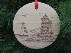 "Bishop & Clerks Lighthouse Ornament. This ornament is hand-sketched then woodburned with intricate detail. It features a red satin ribbon perfect for hanging, measures 2 3/4"" in diameter, and is varnished four times. The reverse side reads, ""Happy Holidays 2012, Bishop & Clerks Light, 1858-1952, Yarmouth, MA."" Each ornament will arrive in a white gift box, perfect for gift giving!   $12.00, via Etsy. Hand Sketch, White Gift Boxes, Red Satin, Lighthouses, Cape Cod, Happy Holidays, Light Up, Ribbon, Gift Ideas"