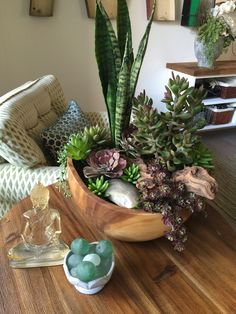 Faux Succulent and Sansevieria Arrangement in a home setting, Done by Instant Jungle instantjungle.com
