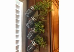 Mason Jar Herb Garden Hanging Planter by PencilsAndPallets Mason Jar Herbs, Mason Jar Herb Garden, Mason Jar Planter, Mason Jars, Hanging Herbs, Hanging Planters, My Home Design, Garden Features, How To Distress Wood