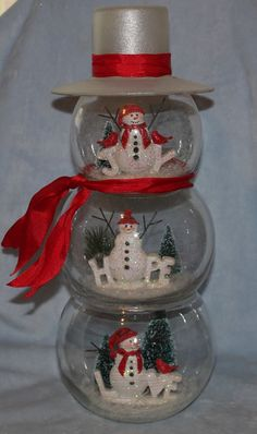 Of all the ones i ve made i finally finished one for myself the hat is made from a candle holder and plate glued together then frosted Snowman Party, Snowman Christmas Decorations, Diy Christmas Presents, Christmas Gift Baskets, Snowman Crafts, Christmas Centerpieces, Christmas Snowman, Christmas Projects, Holiday Crafts