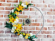 Bicycle Wheel Wreath - Make this wreath with an old bike wheel and fake flowers from the dollar store. Recycle bike tires for cute spring decor.