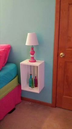 Crates from Michael's that I made into nightstands... $15 a piece! Lamps are from walmart that i painted to match. Aqua, pink and teal girls room ♡