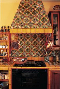 Tiled hood and Mexican style back splash [ MexicanConnexionforTile.com ] #kitchen #Talavera #Mexican